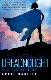 The image shows the cover of April Daniels' novels 'Dreadnought'. Dreadnought show a feminine silhouetted in black standing on a black hillside. She is wearing a blue flowing cape that is blowing sideways to the left, and is looking towards a city skyline that is rendered in pastel pinks and greys. Above the city is a blue sky.