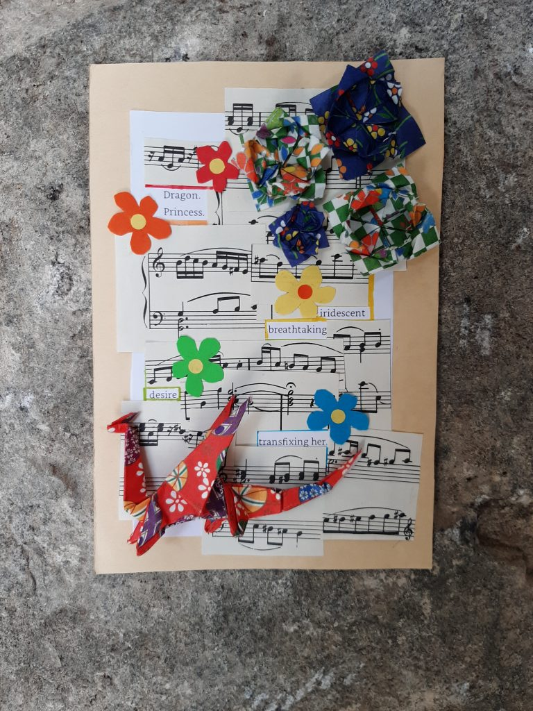 Image shows a final price of poetry constructed of text, sheet music, an origami dragon, flowers in red, orange, green and blue, and origami flowers. The unobscured text reads: Dragon Princess. iridescent, breathtaking desire transfixing her.