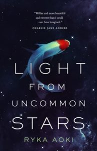 The image shows the cover of Ryka Aoki's novel 'Light From Uncommon Starts'. It is a blue black night sky, in the center of the cover against the sky a Koi carp swims as if underwater.
