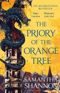 The image shows the cover of Samantha Shannon's novel 'The Priory of the Orange Tree'. The cover shows a sky of orange and gold above a city of peaked roofs. In the forefront on the left-hand side there is a large stone tower with a cupola roof. Around the tower a blue dragon is curled. It dominates the tower and roars out across the city.