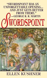The image shows the original cover art for Ellen Kushner's novel 'Swordspoint'. The image is rendered in mostly washed pastel colours. int he centre of an ornate archway, as part of a cirty, stand two figures one is looking directly out of the cover - their pale hair is blowing in the wind, the one of on the left is facing them. The are wearing ornate and flowing clothes.