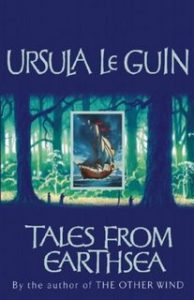 The image shows the cover of Ursula Le Guin's novel 'Tales From Earthsea'. The cover has a blue colour palate. In the centre third of the cover there is a sparse forrest scence of the trunks of trees rendered in greens and blues. In the very centre of that - positioned between two tree trunks - is a regtangular frame of a blue sky and sea, on which a galleon is at full sale.