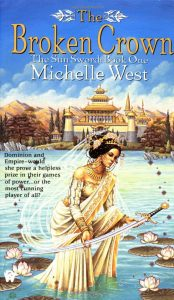 Image shows the cover of Michelle's West's 'The Broken Crown' - book 1 of The Sun Sword series. In the centre front of the image a woman stands in the water, her long white and gold robes trailing beneath the blue. She is holding in her hands a long slightly curved silver sword with a black pommel and gold filigree. Her shoulders are bare and her hair is tied up and adored with jewels and flowers. There are white lilies and lily pads around her. In the background there is a gorgeous building with a 3 tiered pagoda style roof and corner towers. There are trees and a mountain range in the background.