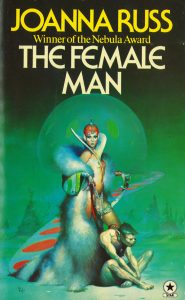 Image contains a cover version of The Female Man. The image is made up of predominatly green tones. In the centre an aliene female stands partially disrobed in powerful satnace while at here feed there is a primitive creature on a leash. Behind her a green planet rises in the background.