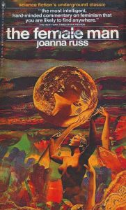 Image contains a cover version of The Female Man. In theimage made up of bronze and orange tones a woman hows her arms up to a moon like planet above her. In the planet is a reflection of her face against the moonscape. The landscape behind the standing figure is made up of versions of her face.