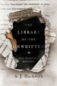 The image shows the cover of A.J. Hackwith's novel 'the Library of the Unwritten'. The cover looks like page of a book, the centre there is a dark hole and the page has been torn out ward, one arm crreps round the corner of the hole on the left handside.