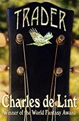The image shows the cover of Charles de Lint's novel 'Trader'. The cover is taken up by a central image of the headstock of a guitar. It is black wood with bronze fold pegs and strings. Across the top of the guitar the title Trader is embossed in Gold lettering, beneath that is a crow looking bird in flight- this is also embossed in gold.