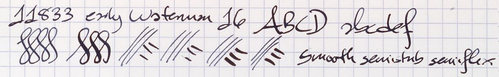 Examples of writing in black ink, including numbers, lower and uppercase letters, and squiggly lines that demonstrate a range of penmanship.
