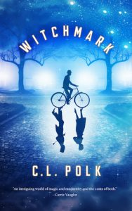 Image shows cover of C.L. Polk's novel 'Witchmark'. Everything is rendered in tonal shares of blue. The scene showers a street with frame of trees in the background. In the centre of the image a male figure in a bowler hat rides a bicycle, where the reflection would be there is instead an inverted image of a couple talking.