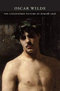The image is a book cover of 'The Uncensored Dorian Grey' shows an oil painting of a young shirtless young man with a laurel crown on his head.